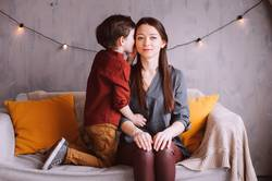 indoor portrait of happy mother and child son