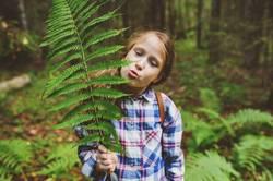 kid girl exploring summer forest