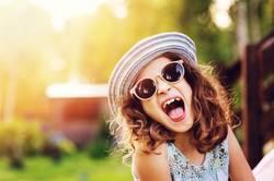summer portrait of happy kid girl on vacation