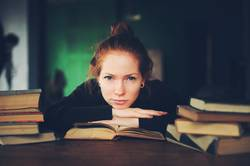 indoor portrait of thoughtful or sad woman learning