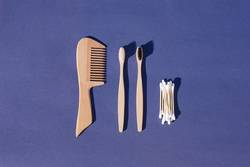 Set of hairbrush, toothbrush and cotton buds made from bamboo