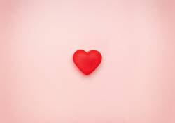 red heart in the center of a pink background