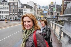 Two Middle Aged Women Standing on Bridge in Amsterdam