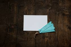 white card with blue tag love written