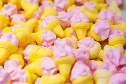 Little sweet candy, pink, yellow, in ice cream shapes