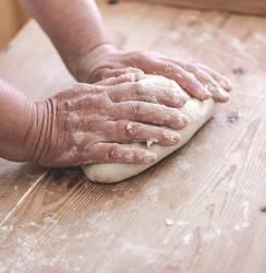 Senior woman makes dough