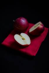 Intensive red apples contrasting to black background