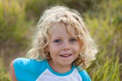 Small child with long blond hair