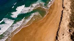 Beautiful aerial view of a beach with waves