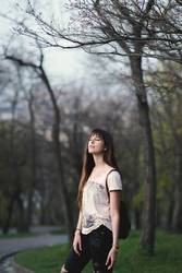 romantic girl with long brown hair in a serene pose