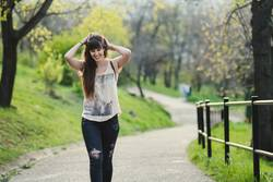 beautiful young woman smiling while walking in the park