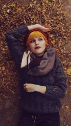 Young redhead woman in an autumn day