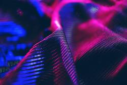 macro of black clothes with pink and blue