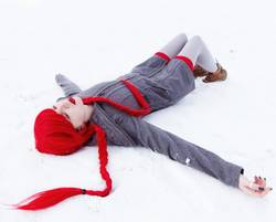 Young woman falling down in snow