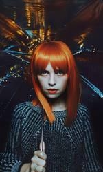 Artistic portrait of a redhead young woman under a umbrella
