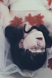 Artistic portrait of a woman sleeping in a bath tub