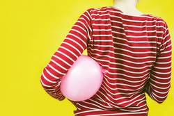 Back view of a girl holding a balloon