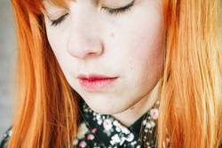 Portrait of a upset young redhead woman