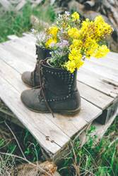 Boots filled with wildflowers
