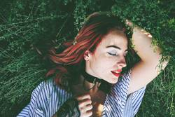 Young and beautiful redhead woman