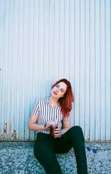 Young redhead woman with a drink