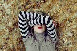 Young woman covering her face with her arms
