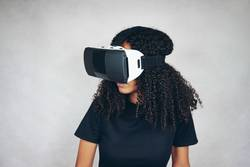 A beautiful young woman wearing VR glasses