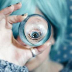 Blue eye viewed through a crystal ball