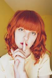 Young redhead woman doing a silent gesture