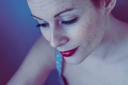 Beautiful freckles woman in blue tones