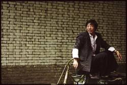 Chinese auf Fahrrad