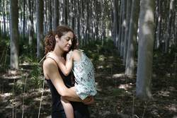 woman hugging her daughter in a forest