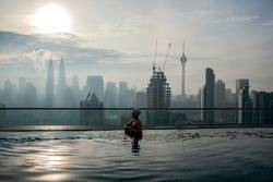 Relaxing in pool and enjoying city panorama.