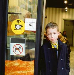Schoolchild at the cafe doorway