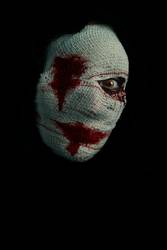 Bandaged terrifying woman with a bloody look