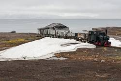 Old industrial train and hut in Ny Alesund, Svalbard islands