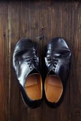 Black shoes on wooden background