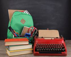 Education concept - school backpack with books