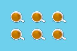 group of coffee cups on a light blue pastel table
