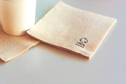 Disposable napkin made from recycled paper.