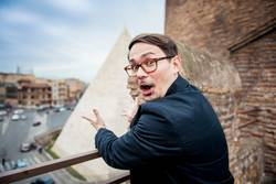 Young man freaks out seeing a pyramid in rome