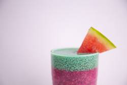 Glass of black chia pudding with watermelon taste