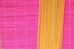 raw spaghetti pasta in colorful background