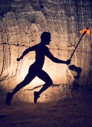 Man running with torch