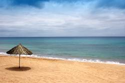 beach of sand with sun hat