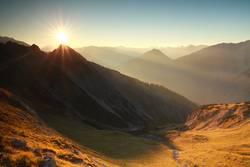 gold autumn sunrise in rocky Alps, Austria