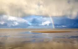 Rainbow on North sea coast after shower, Holland