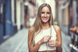 Young woman smiling in urban background.