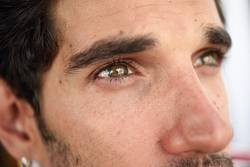 Close-up portrait of young man with beautiful eyes