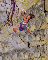 Female climber gripping the edge.